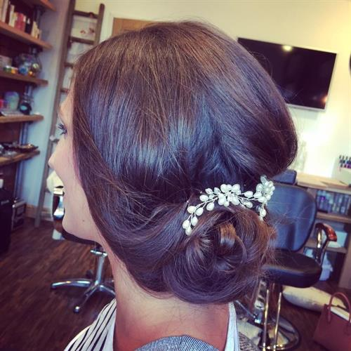 Sleek and glossy boho bridal up do