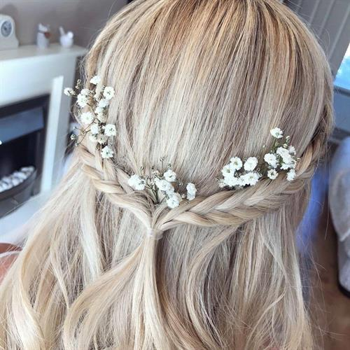Bridal hair with plaits and gypsophilia by our bridal hair expert Suezanna Ward
