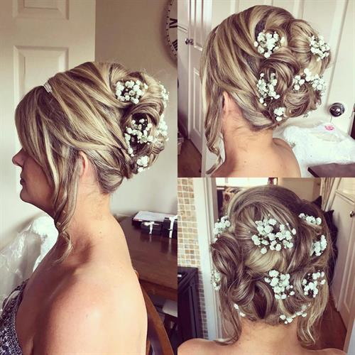 Amazing bridal up do with added gypsophilia to wow the groom