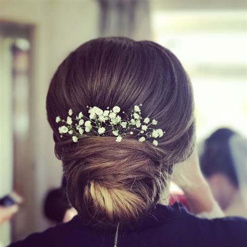 Sleek bun for a bridesmaid at a beautiful boho wedding.