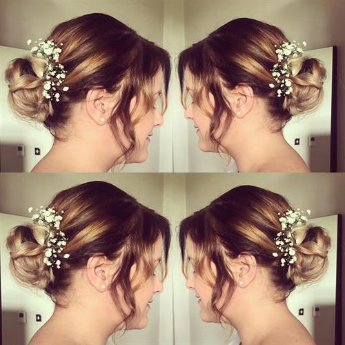 Gorgeous boho hairstyle with added fresh flowers.