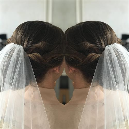Bridal up do by Make My day in Kenilworth, Warwickshire.