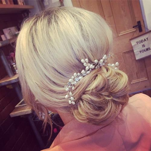 Beautiful hair bun suitable for wedding or prom hair at Make My Day Make Up Studio
