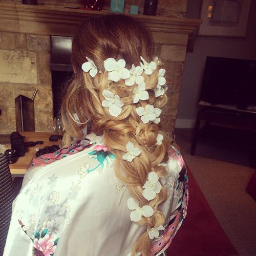 Dreamy boho wedding hair. Fishtail plait with lots of little plaits and added bridal flower vine