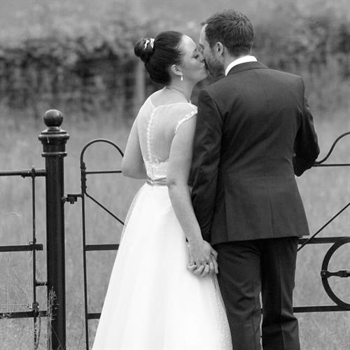 Bride and groom on their wedding day. Bridal hair up with top knot detail