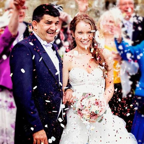 Wedding day confetti shot. Natural bridal hair and make up by Suezanna Ward