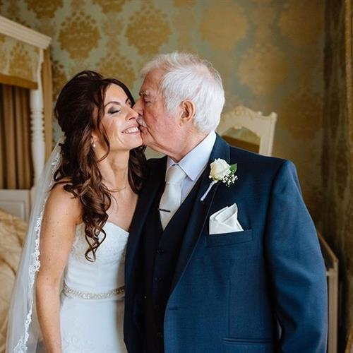 a special moment between the bride and father of the bride on her wedding day at Warwick House in Southam. Hair and make up by Suezanna Ward