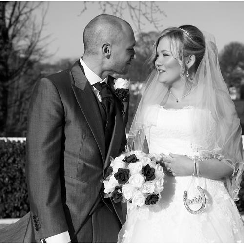Romantic moment between the bride and groom at their Warwick House wedding. Elegant bridal hair and make up by suzanna Ward