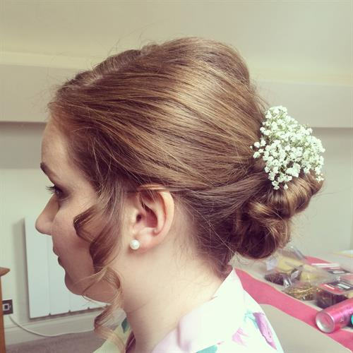 Neat boho up do ideal for bride or bridesmaid. Added gypsophilia to add to the boho theme