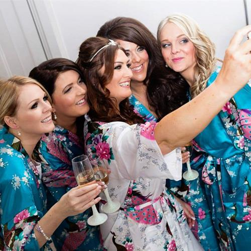 Bride and her bridesmaids for a wedding party selfie.