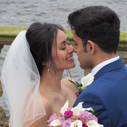 Happy bride on her wedding day with her groom. Bridal hair and make uo by Make My Day Make Up Studio