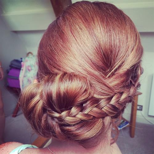 Plaited up do perfect for bridesmaids or prom. Boho hair styling by suezanna Ward